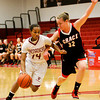 Indiana University Southeast guard Tionna Peters drives the ball past Grace College guard Sarah Feasby during their game at IUS on Wednesday. IUS won the game, 68-67. Staff photo by Christopher Fryer