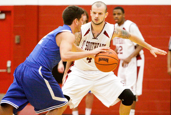 Indiana University Southeast guard Haris Batalevic covers Berea College guard Bryce Carlton during their game at IU Southeast on Tuesday. Staff photo by Christopher Fryer