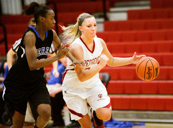Indiana University Southeast guard Heather Wheat drives the ball down court during their home game against Berea College on Tuesday. IU Southeast won the game 66-54. Staff photo by Christopher Fryer