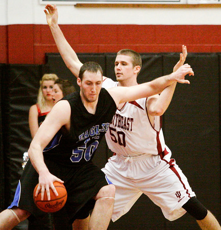Indiana University Southeast forward Chet Werncke guards Alice Lloyd College center Terry Muse during their game in the KIAC tournament at IUS on Saturday. IUS won the game, 77-68. Staff photo by Christopher Fryer