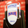 The Indiana University Southeast men's basketball team's National Association of Intercollegiate Athletics Semifinalist trophy sits on a table during a ceremony on Wednesday afternoon to honor their appearance in the tournament earlier this month. The Grenadiers finished their season with a 30-5 overall record, and the final four appearance was a first in the school's history. Staff photo by Christopher Fryer