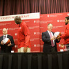 New Albany Mayor Jeff Gahan, left, and Jeffersonville Mayor Mike Moore are presented with basketballs signed by the Indiana University Southeast men's basketball team during a ceremony on Wednesday afternoon to honor their National Association of Intercollegiate Athletics Final Four appearance earlier this month. The Grenadiers finished their season with a 30-5 overall record, and the final four appearance was a first in the school's history. Staff photo by Christopher Fryer