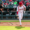 Louisville's Drew Ellis drops the bat and heads for first during the Cardinals' game against Northern Kentucky at Slugger Field on Wednesday. Staff Photo By Josh Hicks