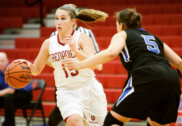 Indiana University Southeast forward Andrea Owen drives the ball down court during their home game against Berea College on Tuesday. IU Southeast won the game 66-54. Staff photo by Christopher Fryer