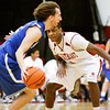 Indiana University Southeast guard Kevin Mitchell covers Berea College guard Aaron Ponder during their game at IUS on Tuesday. Staff photo by Christopher Fryer