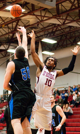 Indiana University Southeast forward Kegan Clark goes up for a shot during their game against Alice Lloyd College in the KIAC tournament at IUS on Saturday. IUS won the game, 77-68. Staff photo by Christopher Fryer
