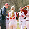 Indiana University Southeast head softball coach Joe Witten talks to his players during a break in play in the first game of their double header against St. Catharine on Thursday afternoon in New Albany. IU Southeast won both games, 13-11 and 7-0. Staff photo by Christopher Fryer