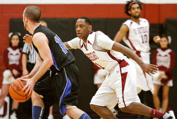Indiana University Southeast guard Kevin Mitchell covers Alice Lloyd College guard Isaac Wilson during their game in the KIAC tournament at IUS on Saturday. IUS won the game, 77-68. Staff photo by Christopher Fryer