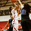 Indiana University Southeast guard Tionna Peters goes up for a shot during their home game against Berea College on Tuesday. IU Southeast won the game 66-54. Staff photo by Christopher Fryer