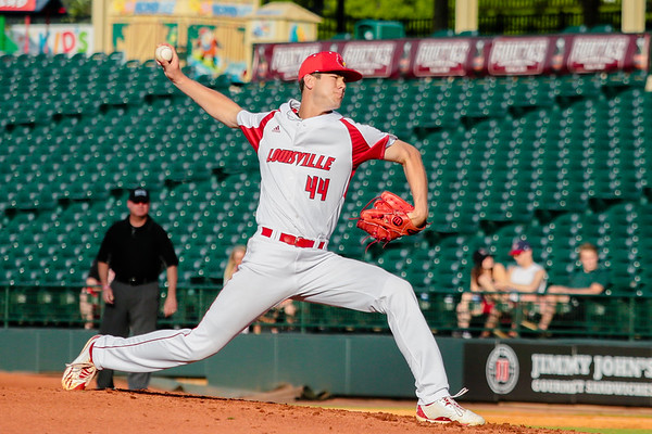 Louisville's Jake Sparger comes onto the field to pitch, following Bryan Hoeing, during the Cardinals' game against Northern Kentucky at Slugger Field on Wednesday. Staff Photo By Josh Hicks
