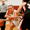 Indiana University Southeast guard Heather Wheat drives the ball past Grace College forward Allison Kaufman during their game at IUS on Wednesday. IUS won the game, 68-67. Staff photo by Christopher Fryer