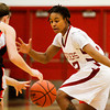 Indiana University Southeast guard Danielle Betts covers Grace College guard Gabby Bryant during their game at IUS on Wednesday. IUS won the game, 68-67. Staff photo by Christopher Fryer