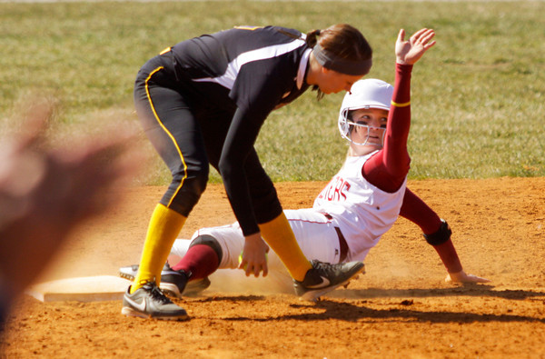 Indiana University Southeast senior Shauna Gramig looks to the umpire for a call after sliding into second base during the first game of their double header against St. Catharine on Thursday afternoon in New Albany. Gramig was safe, and IU Southeast won both games, 13-11 and 7-0. Staff photo by Christopher Fryer