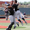 ANNA NORRIS/CHRONICLE<br /> Western Michigan's Mitchell Ho (25), left, and Nick Vofelmeier (8), rush to celebrate with closing pitcher Kyle Mallwitz after the Broncos beat Kent State 12-7  in the Mid-American Conference championship game at All-Freight Stadium in Avon Sunday afternoon.