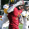ANNA NORRIS/CHRONICLE<br /> Oberlin wide receiver Robby Reinheimer runs down the field for a first down as Allegheny's Clarence Long goes in for the tackle in the second quarter Saturday afternoon at Bailey Field in Oberlin.