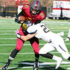 ANNA NORRIS/CHRONICLE<br /> Oberlin wide receiver Ryan Gleeson runs the ball up field for a gain of yards as Allegheny's Chase Balla makes the stop in the second quarter Saturday afternoon at Bailey Field in Oberlin.