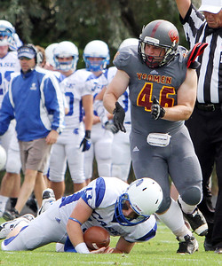 ANNA NORRIS/CHRONICLE Oberlin College defensive lineman C.J. Ihle reacts after sacking Case Western Reserve quarterback Billy Beecher in the first half of the season home opener yesterday at Savage Stadium in Oberlin.