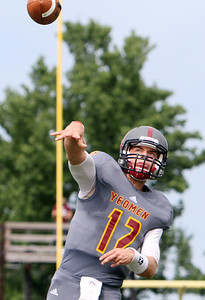ANNA NORRIS/CHRONICLE Oberlin College quarterback Lucas Poggiali makes a pass intended for a receiver in the end zone in the second half of the season home opener yesterday at Savage Stadium in Oberlin.