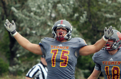 ANNA NORRIS/CHRONICLE Oberlin College defensive lineman Kirby Livingston lifts his arms up in celebration after Case Western Reserve quarterback was sacked in the second half of the season home opener yesterday at Savage Stadium in Oberlin.