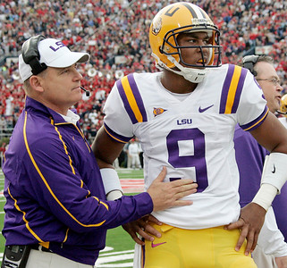 LSU football coach Les Miles tries to settle his quarterback Jordan Jefferson (9) after he threw a first quarter interception against Mississippi during their NCAA college football game in Oxford, Miss., Saturday, Nov. 21, 2009. Mississippi defeated No. 10 LSU 25-23.  (AP Photo/Rogelio V. Solis)