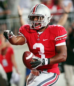 Ohio State running back Brandon Saine (3) celebrates after scoring a touchdown during the first half of an NCAA college football game against Marshall, Thursday, Sept 2, 2010, in Columbus, Ohio. Ohio State won 45-7. (AP Photo/Terry Gilliam)