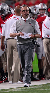 Ohio State coach Jim Tressel works the sidelines against Marshall during the second half of an NCAA college football game Thursday, Sept. 2, 2010, in Columbus, Ohio. Ohio State beat Marshall 45-7. (AP Photo/Terry Gilliam)
