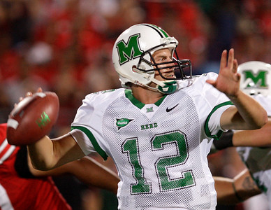 Marshall's Brian Anderson drops back to pass against Ohio State during the second quarter of an NCAA college football game Thursday, Sept. 2, 2010, in Columbus, Ohio. (AP Photo/Jay LaPrete)
