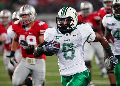 Marshall's Ahmed Shakoor (6) outruns Ohio State's Dan Bain to score a touchdown after Marshall blocked a field goal attempt during the first quarter of an NCAA college football game Thursday, Sept. 2, 2010, in Columbus, Ohio. (AP Photo/Terry Gilliam)