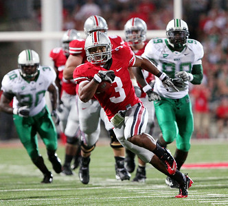 Ohio State running back Brandon Saine (3) runs in for a touchdown during the first half of an NCAA college football game against Marshall, Thursday, Sept 2, 2010, in Columbus, Ohio. (AP Photo/Terry Gilliam)