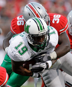 Ohio State's Brian Rolle, top, tackles Marshall's Andre Booker during the first quarter of an NCAA college football game, Thursday, Sept. 2, 2010, in Columbus, Ohio. (AP Photo/Jay LaPrete)