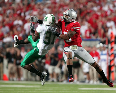 Marshall's Omar Brown (31) knocks the ball away from Ohio State's DeVier Posey, right, during  an NCAA college football game,  Thursday, Sept 2, 2010, in Columbus, Ohio. Ohio State won 45-7. (AP Photo/Terry Gilliam)