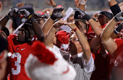 "Ohio State coach Jim Tressel sings ""Carmen Ohio"" after their 45-7 win over Marshall in an NCAA college football game Thursday, Sept. 2, 2010, in Columbus, Ohio. (AP Photo/Jay LaPrete)"