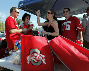 Ohio State fans dance while tailgating before an NCAA college football game between Marshall and Ohio State, Thursday, Sept 2, 2010, in Columbus, Ohio. Ohio State won 45-7. (AP Photo/Terry Gilliam)