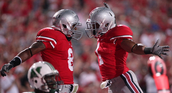 Ohio State's DeVier Posey, left, and Daniel Herron celebrate Posey's touchdown against Marshall during the second half of an NCAA college football game Thursday, Sept. 2, 2010, in Columbus, Ohio. Ohio State beat Marshall 45-7. (AP Photo/Terry Gilliam)
