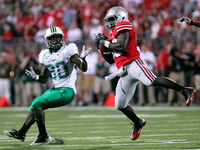 Ohio State linebacker Brian Rolle, right, intercepts a pass intended for Marshall's Mario Harvey during the first half of an NCAA college football game, Thursday, Sept 2, 2010, in Columbus, Ohio. (AP Photo/Terry Gilliam)