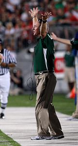 Marshall coach Doc Holliday shouts at his team as they play against Ohio State during the second quarter of an NCAA college football game Thursday, Sept. 2, 2010, in Columbus, Ohio. (AP Photo/Jay LaPrete)