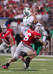 Ohio State's Tyler Moeller, left, sacks Marshall's Brian Anderson causing a fumble during the second half of an NCAA college football game Thursday, Sept. 2, 2010, in Columbus, Ohio. Ohio State beat Marshall 45-7. (AP Photo/Terry Gilliam)