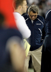 In this Saturday, Nov. 7, 2009 photo, Penn State coach Joe Paterno walks the sideline during the second half of an NCAA college football game against Ohio State in State College, Pa. Ohio State won 24-7. Ohio State got over its big-game blues by beating up on Penn State. There's little time to rest, though: Iowa is coming to the Horseshoe next with first place in the Big Ten on the line. (AP Photo/Carolyn Kaster)