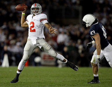 Ohio State quarterback Terrelle Pryor (2) scrambles and throws as Penn State defender as Penn State linebacker Josh Hull (43) moves in during the second half of an NCAA college football game in State College, Pa., Saturday, Nov. 7, 2009. Ohio State won 24-7. (AP Photo/Carolyn Kaster)
