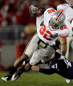 Ohio State's Ray Small (82) is tackled by Penn State punter Jeremy Boone (41) during the second half of an NCAA college football game in State College, Pa., Saturday, Nov. 7, 2009. Ohio State won 24-7.(AP Photo/Carolyn Kaster)
