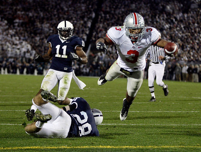 ** CORRECTS ID TO RUNNING BACK BRANDON SAINE, NOT QUARTERBACK TERRELLE PRYOR ** Ohio State running back Brandon Saine (3) dives into the end zone for a touchdown after breaking a tackle attempt by Penn State's Drew Astorino (28) and Navorro Bowman (11) during the second half of an NCAA college football game in State College, Pa., Saturday, Nov. 7, 2009. Ohio State won 27-7. (AP Photo/Carolyn Kaster)
