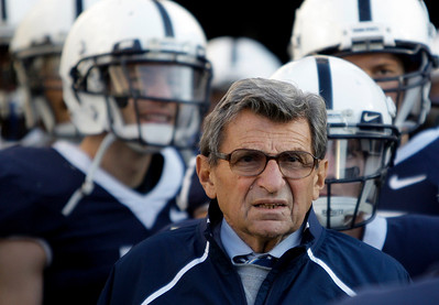 In this Saturday, Nov. 7, 2009 photo, Penn State Coach Joe Paterno stands with his players before taking the field for an NCAA college football game against Ohio State in State College, Pa. Ohio State won 24-7. Ohio State got over its big-game blues by beating up on Penn State. There's little time to rest, though: Iowa is coming to the Horseshoe next with first place in the Big Ten on the line. (AP Photo/Carolyn Kaster)
