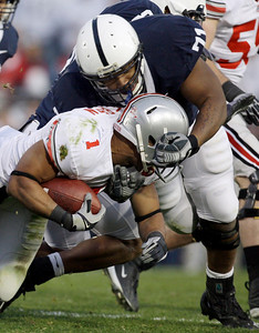 Penn State defensive lineman Devon Still (71) takes down Ohio State running back Dan Herron (1) during the first half of an NCAA college football game in State College, Pa., Saturday, Nov. 7, 2009. (AP Photo/Carolyn Kaster)