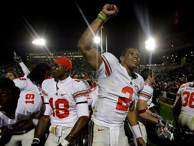 Ohio State quarterback Terrelle Pryor  (2) celebrates with the Ohio State student section after defeating Penn State 24-7 in an NCAA college football game in State College, Pa., Saturday, Nov. 7, 2009. Left of Prior is teammate Travis Howard. (AP Photo/Carolyn Kaster)