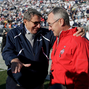 Penn State head coach Joe Paterno, left, chats with Ohio State head coach Jim Tressel, right, before the start of their NCAA college football game in State College, Pa., Saturday, Nov. 7, 2009. Ohio State won 24-7.(AP Photo/Carolyn Kaster)
