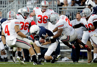 Penn State wide receiver Graham Zug (5) is surrounded by Ohio State players Kurt Coleman (4), Brian Rolle (36) , Austin Spitler (38) and Devon Torrence (10) as defensive back Russell Anderson (21) tackled him during the first half of an NCAA college football game in State College, Pa., Saturday, Nov. 7, 2009. Ohio State won 24-7.(AP Photo/Carolyn Kaster)