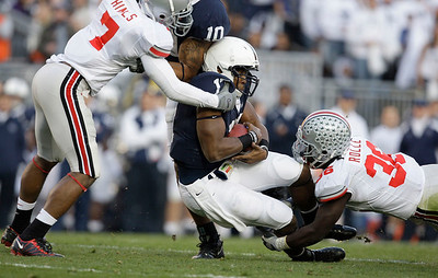 Penn State quarterback Daryl Clark, center, is tackled by Ohio State's Jermale Hines (7) and Brian Rolle during the first half of an NCAA college football game in State College, Pa., Saturday, Nov. 7, 2009. Ohio State won 24-7.(AP Photo/Carolyn Kaster)