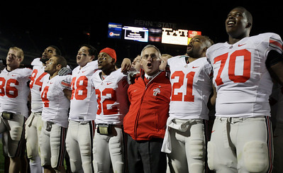 Members of the Ohio State football team join head coach Jim Tressel as they sing their school's alma mater after beating Penn State in an NCAA college football game in State College, Pa., Saturday, Nov. 7, 2009. Ohio State won 24-7. From left Jake Ballard (86), Doug Worthington (84), Jaamal Berry (4), Spencer Smith (48) , Taylor Rice (32), Jim Tressell, Russell Anderson (21), and Bryant Browning (70).(AP Photo/Carolyn Kaster)