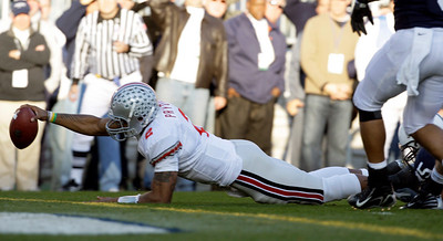 Ohio State quarterback Terrelle Pryor dives into the end zone for a touchdown against Penn State during the first half of an NCAA college football game in State College, Pa., Saturday, Nov. 7, 2009. (AP Photo/Carolyn Kaster)
