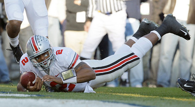 Ohio State quarterback Terrelle Pryor lands in the end zone for a touchdown against Penn State during the first half of an NCAA college football game in State College, Pa., Saturday, Nov. 7, 2009. (AP Photo/Carolyn Kaster)